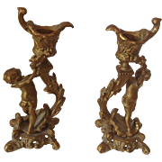 Pair of small 19th Century bronze dore figural French candlesticks