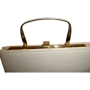 """Vintage Andre handbag bone color with gold tone frame and handle 9 3/4"""" long by 5 1/2"""" high"""