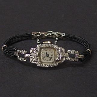 Vintage 14 Karat gold & diamond Waltham Premier Watch