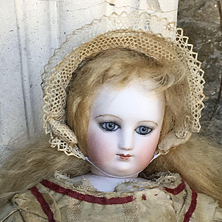 Wonderful french fashion bisque doll with articulate bisque arms , 16 inches tall
