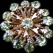 Vintage 1980s Peridot Colored Rhinestone and Gold Tone Metal Starburst Flower Brooch