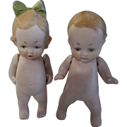 "German Bisque 3"" Boy and Girl Dolls"