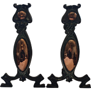 A pair of Art Nouveau Copper and Cast Iron Andirons