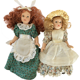 Small Bisque Sister Dolls