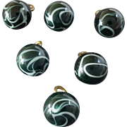 Six Antique Lampworked Men's Vest Glass Buttons White Swirls on Green 7/16""