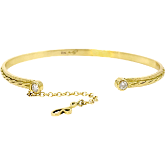 Two Diamond 18 Karat Infinity Twist Cuff Bracelet with Chain and Signature Dangle Charm