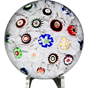 Antique Baccarat scattered millefiori on upset muslin paperweight.