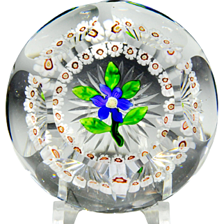 Antique Baccarat faceted blue clematis and millefiori garland paperweight.