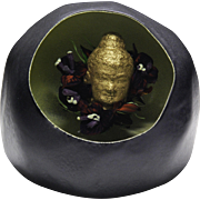 """Melissa Ayotte """"Golden Buddha in Gray Stone"""" paperweight."""