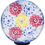 Baccarat 1973 millefiori circlets on upset muslin glass paperweight.