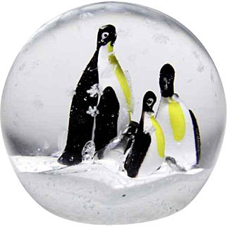 Unknown maker, possibly Chinese three penguins in snow glass paperweight.