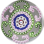 Antique Clichy C-scroll millefiori garlands paperweight.