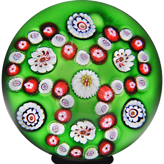 Antique Clichy trefoil millefiori garland on green ground glass paperweight.