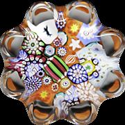 John Deacons orange scramble miniature daisy-pressed glass paperweight