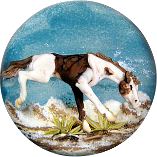 """Jim D'Onofrio """"Bucking Pinto"""" brown and white horse compound paperweight."""