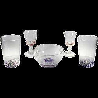 Post-Classic English glassware set with millefiori design.