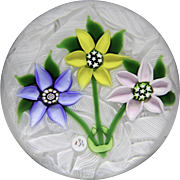 """J"" Glass 1979 three-flower bouquet paperweight"