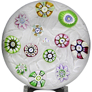 Perthshire Paperweights 1977 spaced millefiori and silhouette canes on upset muslin paperweight
