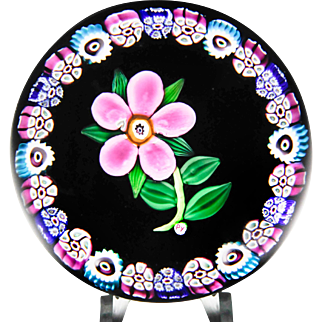 Paul Ysart pink flower with border garland paperweight.