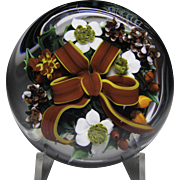 "Rick Ayotte 1987 ""Christmas Bouquet"" paperweight."