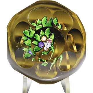 Antique Saint Louis faceted nosegay on amber-flash ground paperweight.