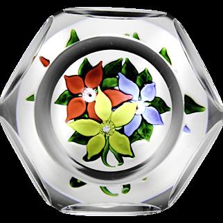 Saint Louis faceted 1971 three-flower bouquet glass paperweight.