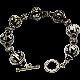 Ann Wasserman Bark Cloth glass bead and silver bracelet.