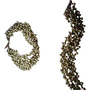 Beautiful green cultured pearl six strand necklace with matching six strand bracelet