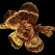 Handmade gold tone wire flower pin