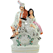 Staffordshire Porcelaine Figurine Scotsman and his Lady