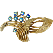 Lisner Blue AB Rhinestone Goldtone Curved Flower Brooch