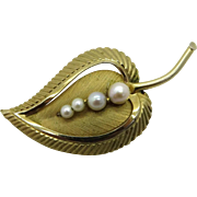 Designer Faux Pearl Gold Tone Curved Leaf Brooch