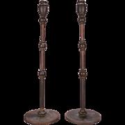 Rare Pair of Antique Louis Comfort Tiffany Bronze Moorish Style Candlesticks, circa 1900
