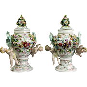 Antique Pair of Meissen Polychrome Figural and Floral Lidded Urns with Cherubs