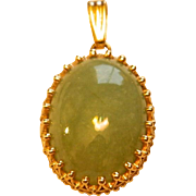 Pretty Oval Pale Green Jadeite Set in 14KT Gold Pendant
