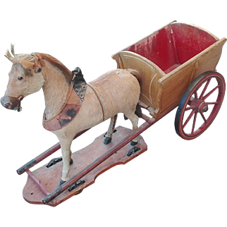 End 19th Wonderful German large pull toy horse with cart, wood base, metal working wheels.