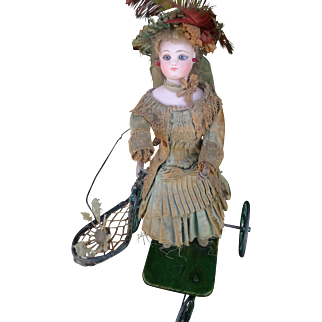 "French Mechanical Toy ""Little Girl Playing Badminton"" by Vichy, working mechanism, in good condition"