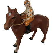 Vintage iron jockey & horse toy collectibles