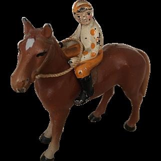 Vintage iron jockey & horse toy collectibles