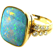 Ring with Australian opal, diamonds, 18K gold.