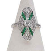 Ring with emeralds and diamonds, 18K white gold.