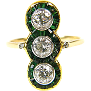 Art deco ring with emeralds and diamonds.