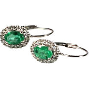 Earrings with emeralds and diamonds, 18K white gold.