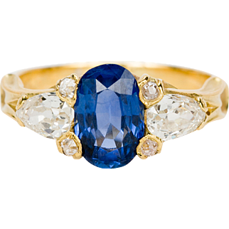 1.63 Sapphire with Swiss/English Brilliant diamond cluster. Valued at £11,100.00 ($13,590.00)