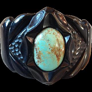 Huge Deep Carved Black Bakelite Clamper Bracelet with Turquoise Cabochon