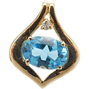 Solid 14K Yellow Gold 0.80ct Oval Blue Topaz w/0.02ct Diamond Accents Pendant