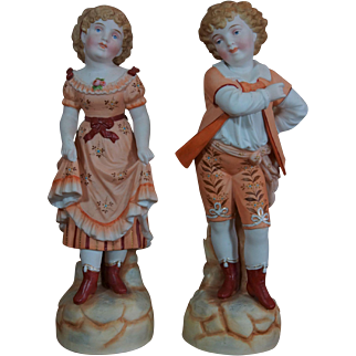 Very lovely all-bisque couple of child statue figures