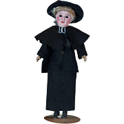 Very interesting mold of German doll character with a priest costume.