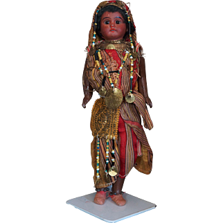 Lovely black Fleischmann doll with an amazing colorful oriental dress.