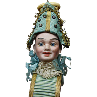 Wonderful and very Uncommon Polichinelle Whistle and Tambourine toy doll by Louis Schneider.